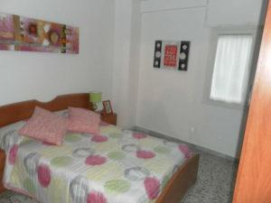 Venta piso Ejea calle Monjas con garaje, terraza y trastero Dormitorio Cama Matrimonio
